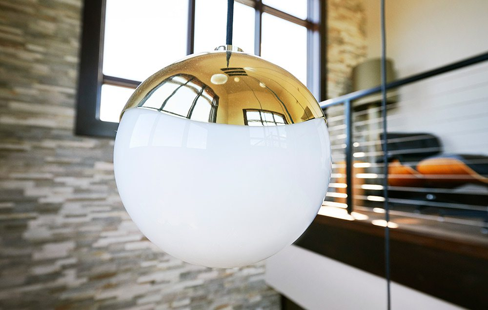 Frosted globe pendent with gold cap