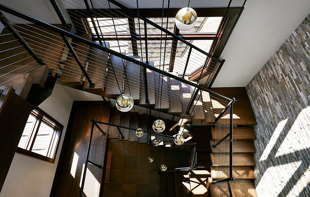 Dramatic staircase in home at Table Rock Lake