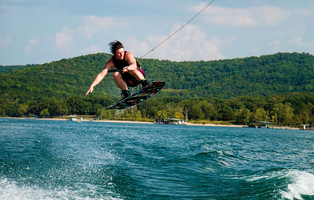Young man wakeboarding on Table Rock Lake