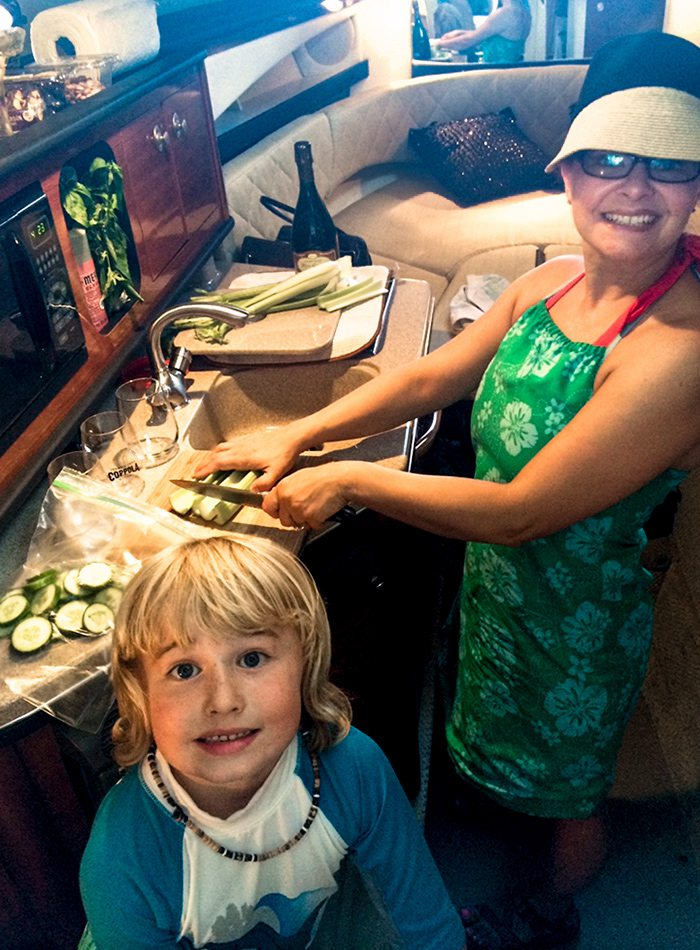 Elle Feldman and family cooking on their cabin cruiser boat