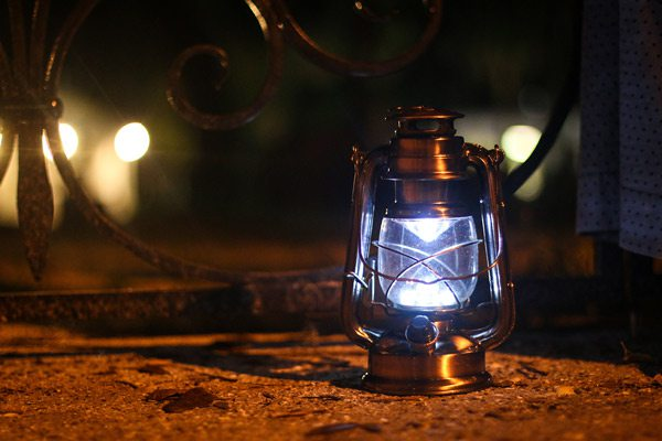 Lantern on a ghost tour Shutterstock image.