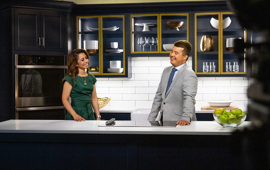 Hosts Melanie Steen and Michael Gibson laugh on the set of filming The Place