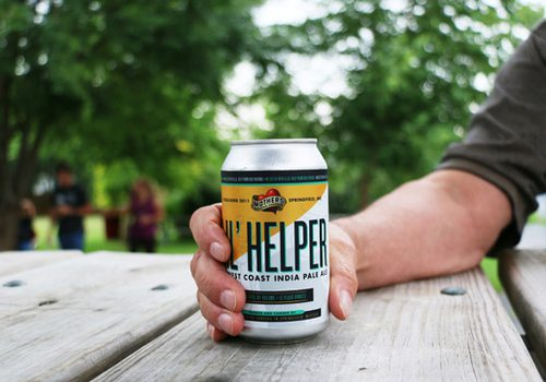 Mother's Li'l Helper IPA in a can on a picnic table.