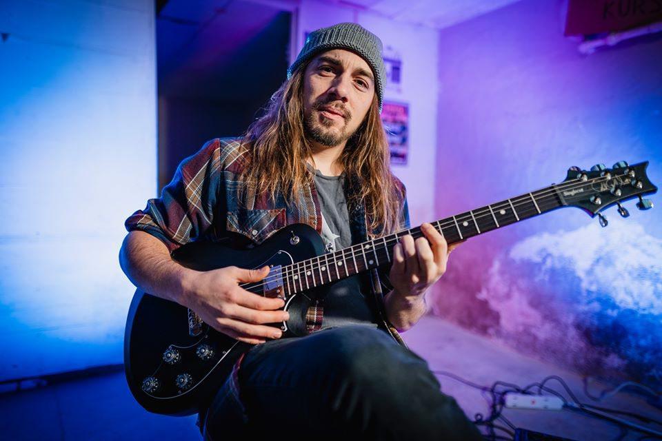 Justin Larkin photo with guitar