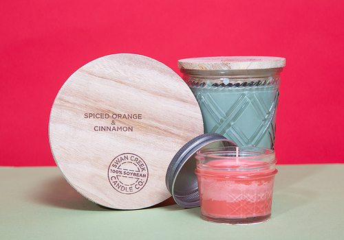 Swan Creek Candle Co. products on red background