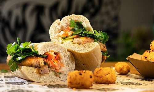 Lucky Tiger Sandwich Co.'s pork belly banh mi and tater tots