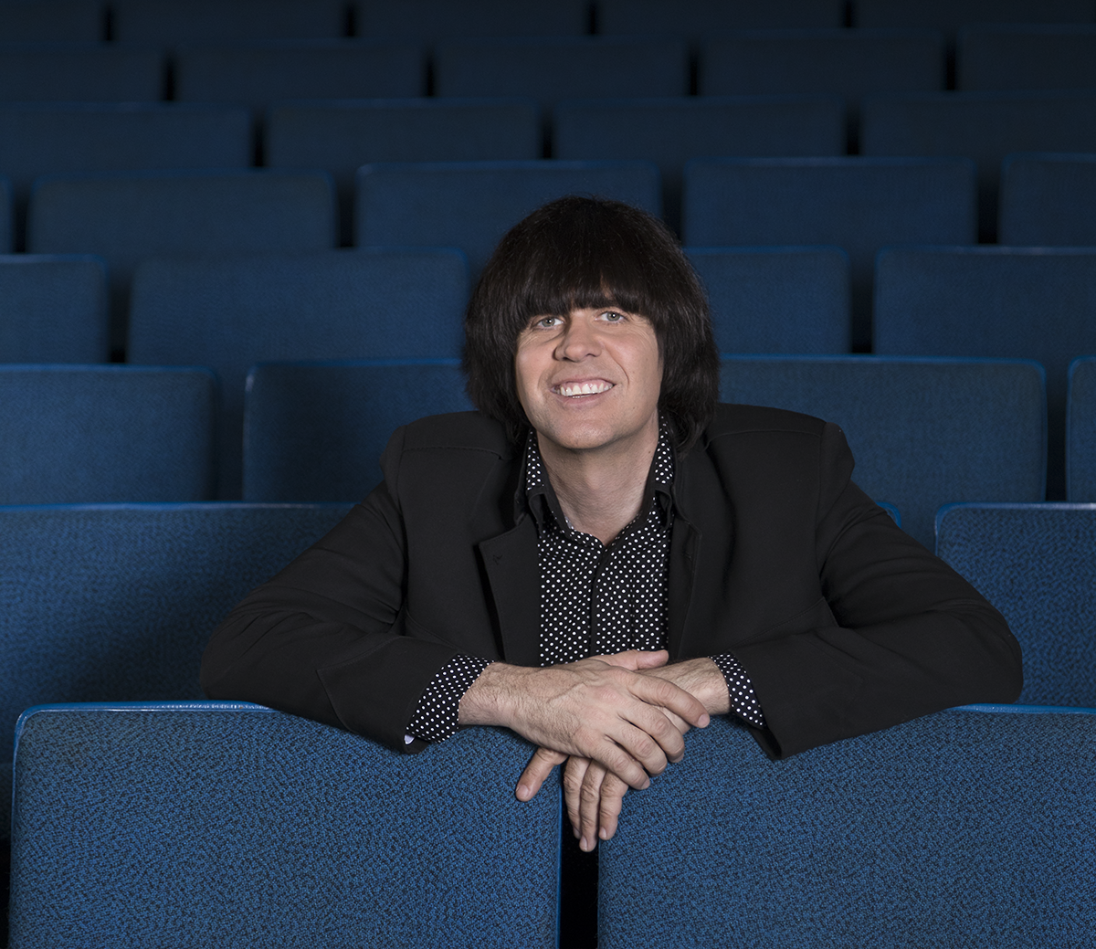 Marty Scott sits in the Caravelle Theater in Branson, where the Liverpool Legends call home.