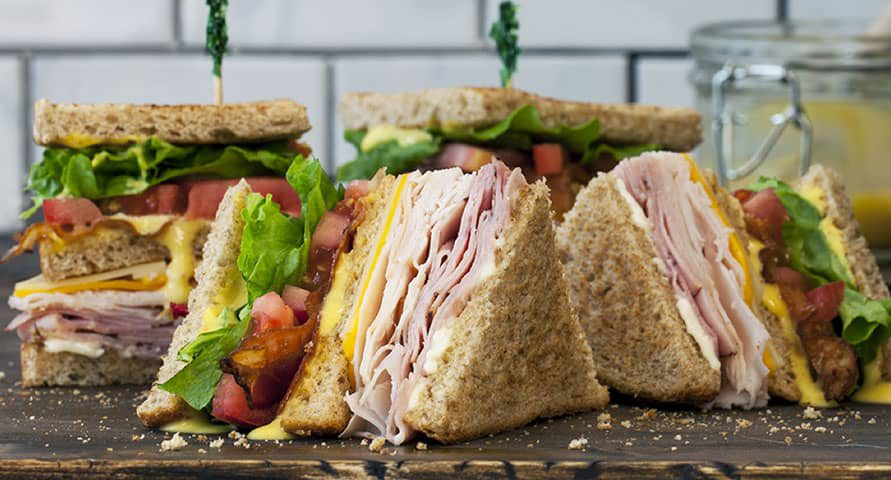 The sandwiches are piled high with meat, veggies or both with ingredients like turkey, bacon, cucumbers and avocado.