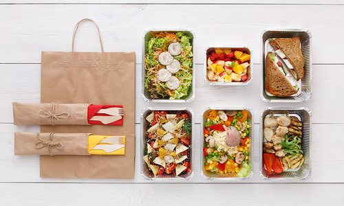 An assortment of meals and food sit in their kits, ready to eat.