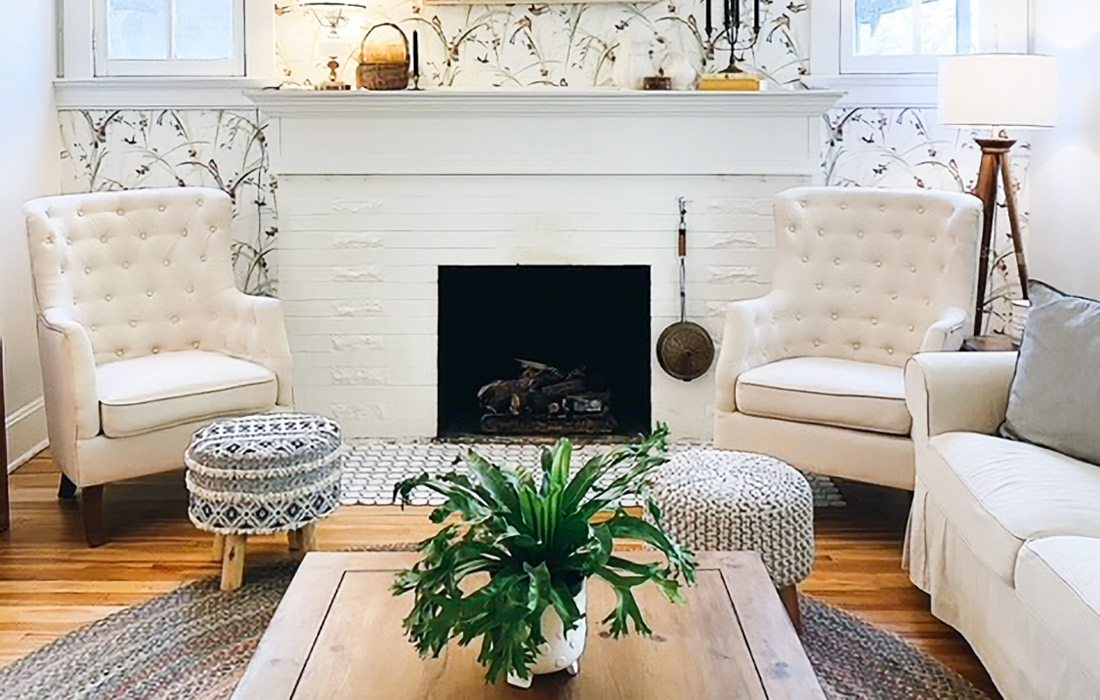 White home with light colored wood floors and plants