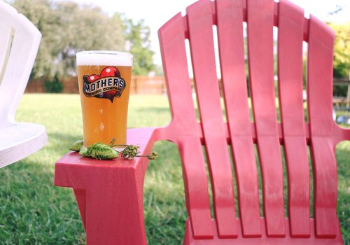 mother's brewing company beer on a lawn chair in the backyard