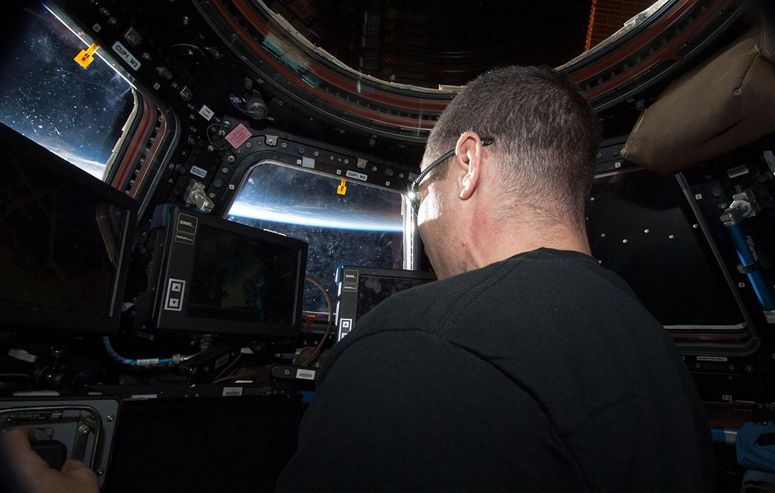 Astronaut Mike Hopkins in The Cupola control tower for the International Space Station