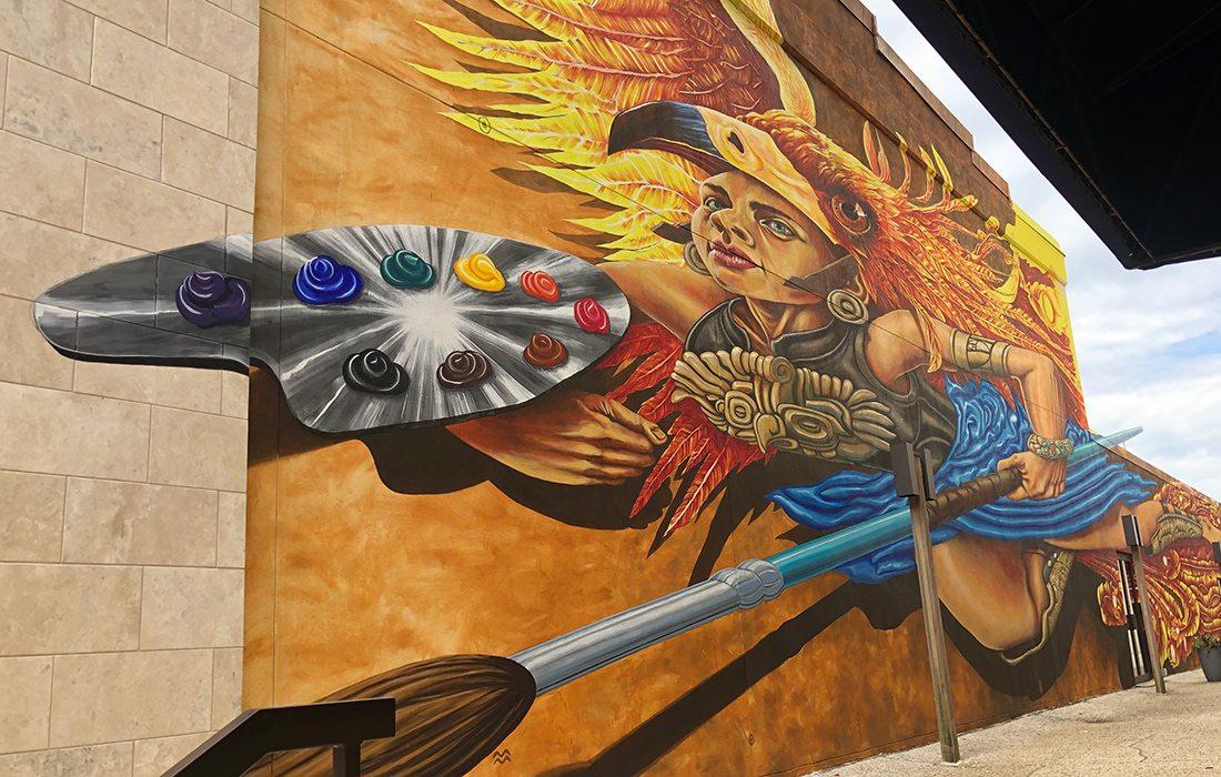 Athena mural located outside Fenix Fayetteville Art Gallery