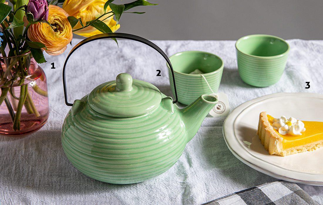 Green tea pot and cups at brunch