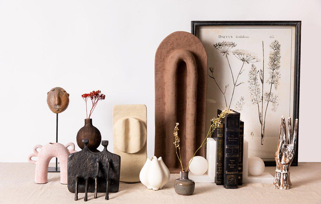 Sculptures arranged on a mantlepiece