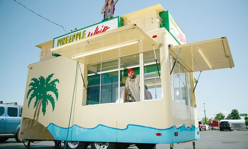 Zach Fortner, Owner of Pineapple Whip in Springfield MO, inside a Pineapple Whip cart