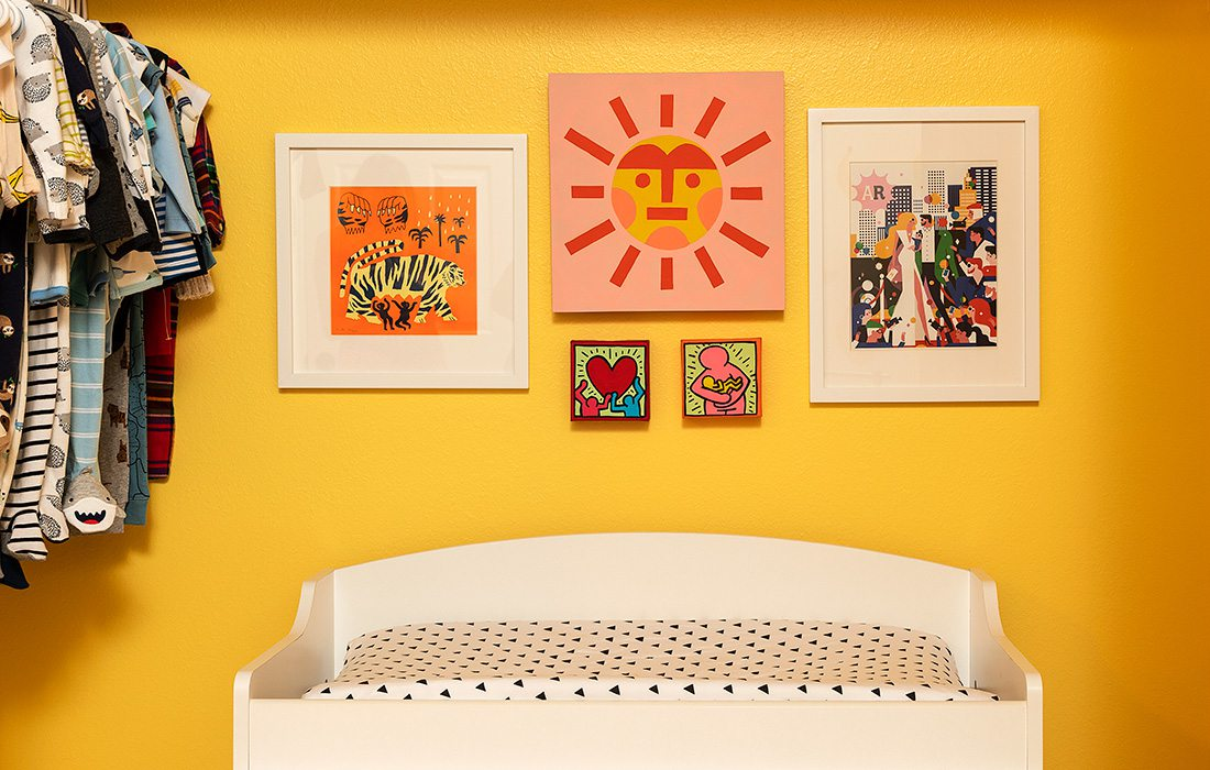 Colorful art gallery over Heather Kane Kohler's baby changing table