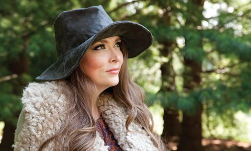 Young woman wearing a chic wide brimmed hat