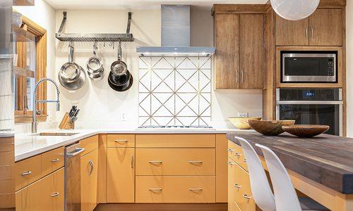 Statement orange cabinets in kitchen design
