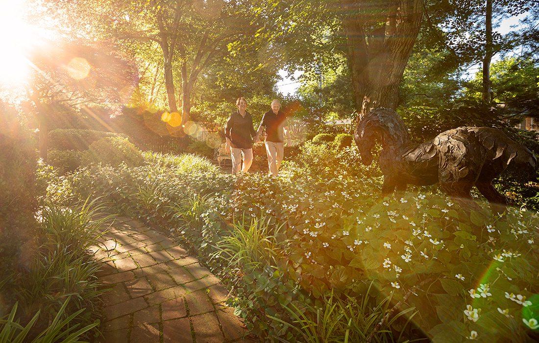 Robert and Peg Carolla in their backyard garden