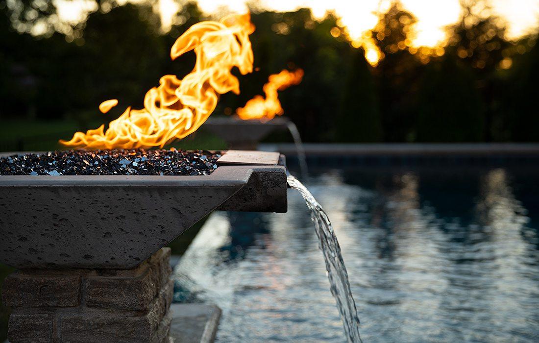 Backyard pool with vanishing waterfall and fire bowls Springfield MO