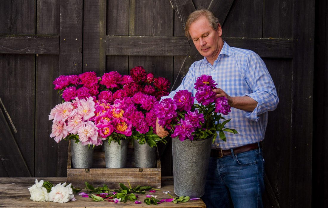 P. Allen Smith with peonies at Moss Mountain Farm in Arkansas