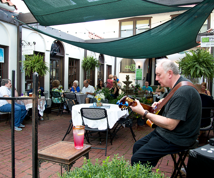 At its monthly themed dinners, Tea Bar & Bites Bakery, Cafe & Catering brings in musicians to perform on its patio.