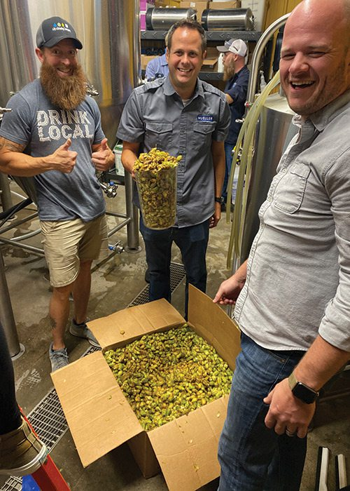 Paul Mueller Company with a box of hops