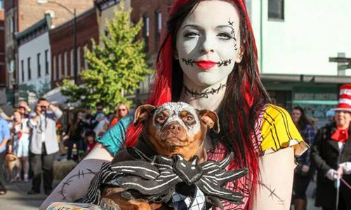 woman in a costume with her dog in springfield