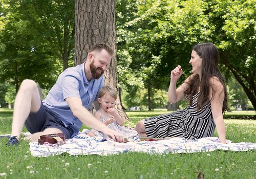 Family of three on a picnic in Phelps Grove Park in Springfield MO