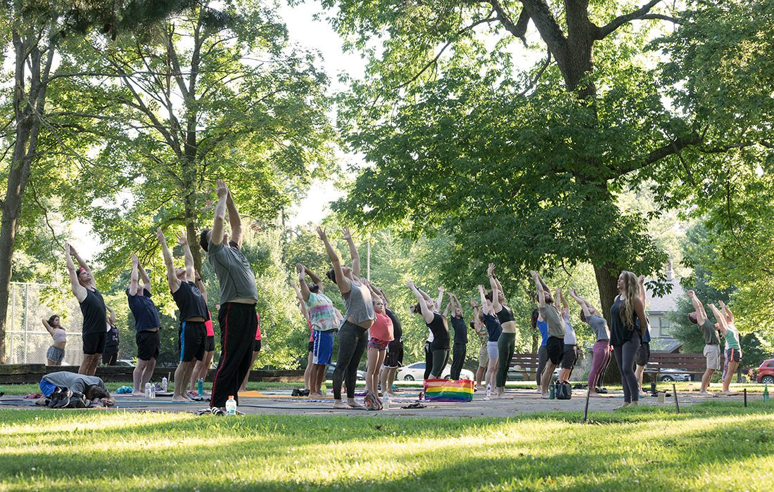 Large group of people doing yoga in Phelps Grove Park in Springfield MO