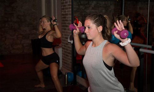 girls using weights at Physique Fitness' Hot Barre yoga class in springfield missouri