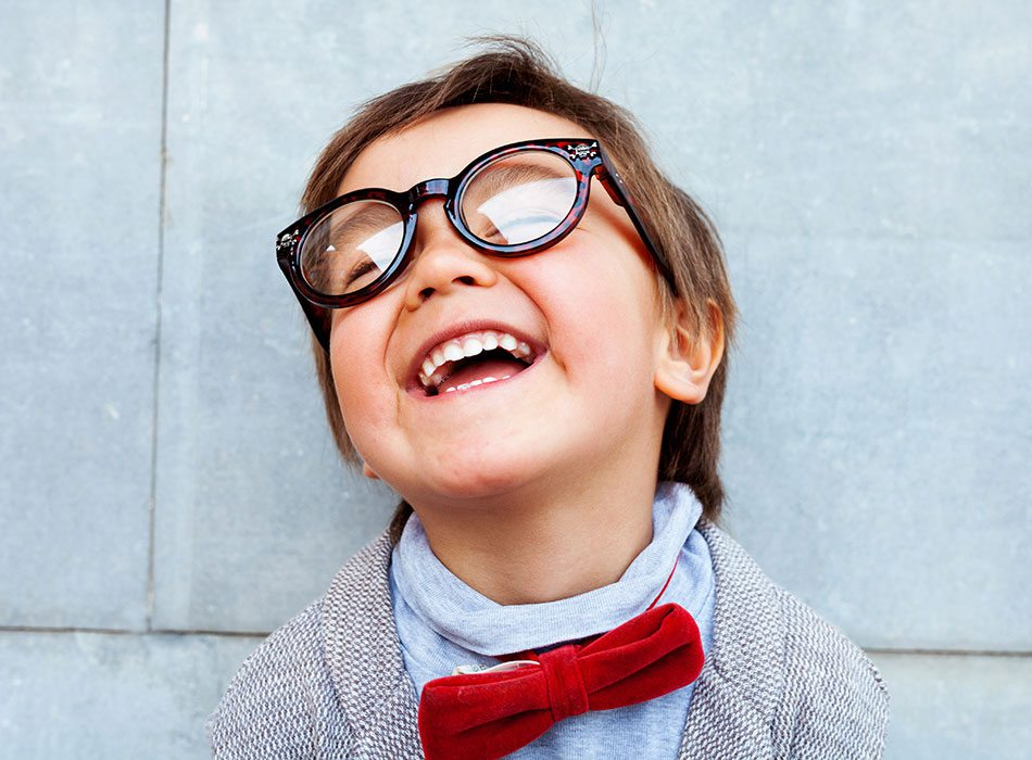 young boy with thick rimmed glasses