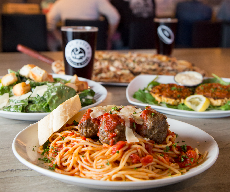 Spaghetti and meatballs, Caesar salad, pizza and crab cakes in hefty portions at The Pitch Pizza & Pub.