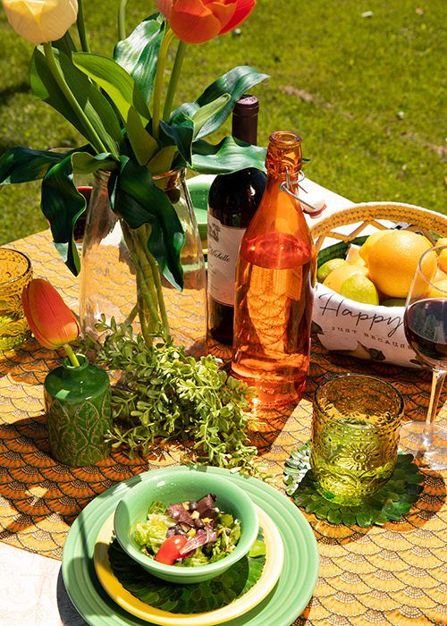 Bright orange and green table setting