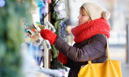woman in red scarf shopping