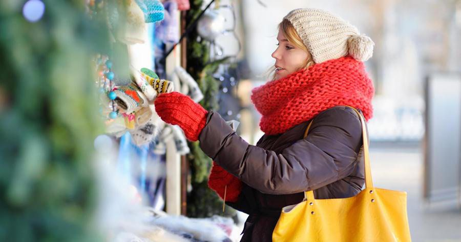 woman looking at christmas decor