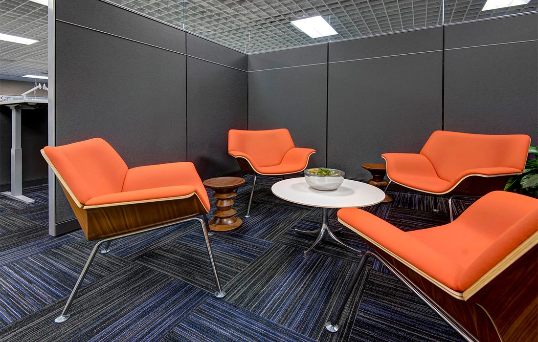 Orange chairs in office cubicle