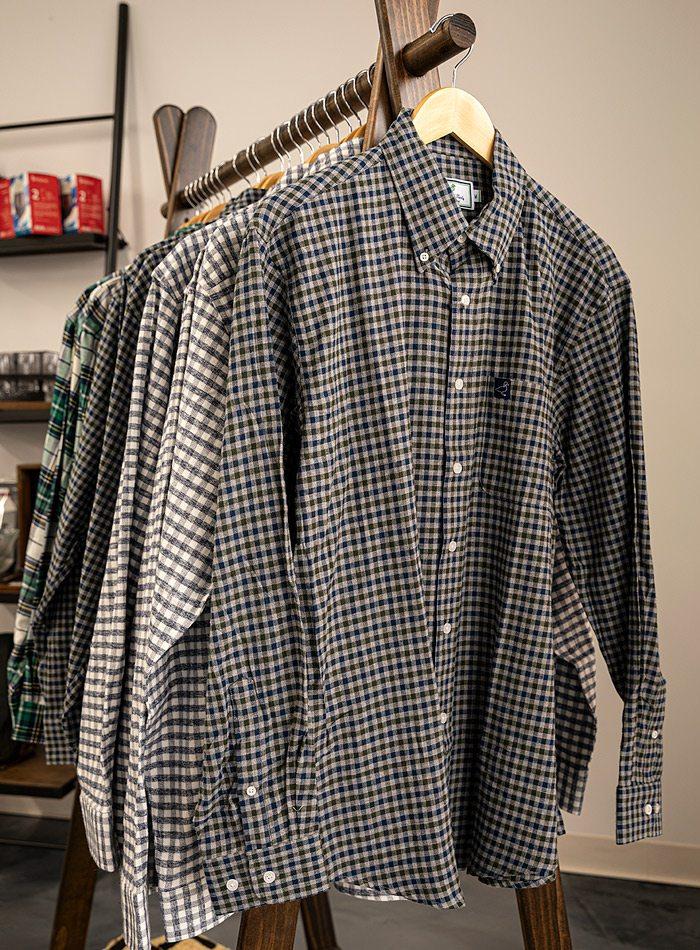 Shirts on a rack.