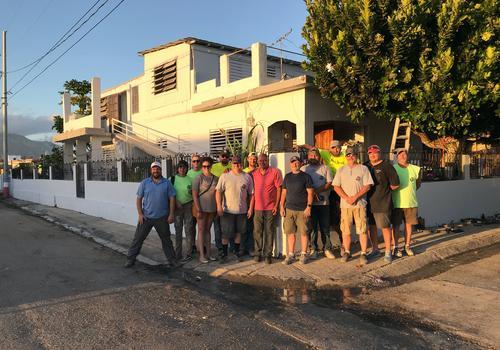 Juanito Borques with the group that renovated his home