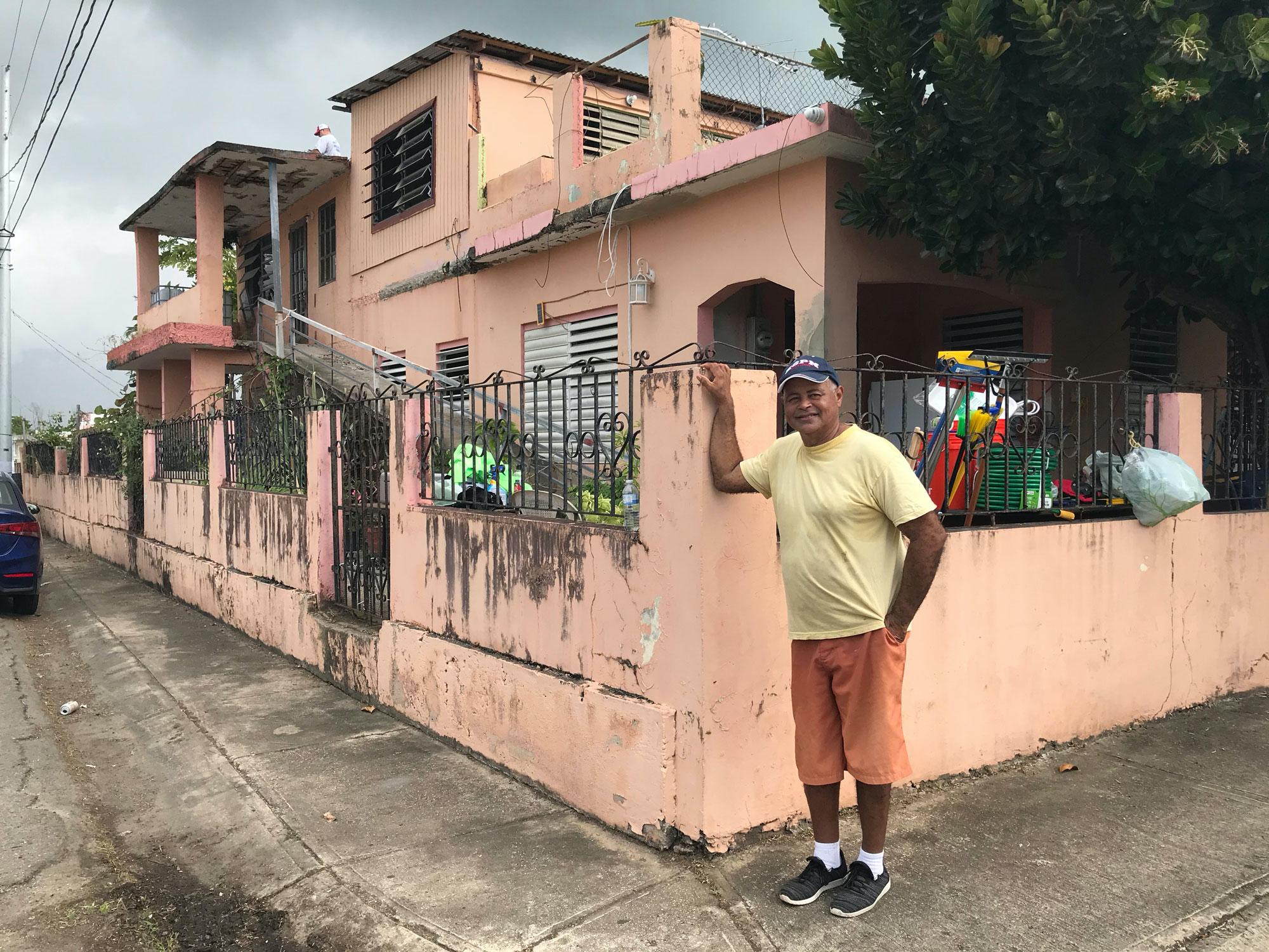 Juanito Borques outside his home.