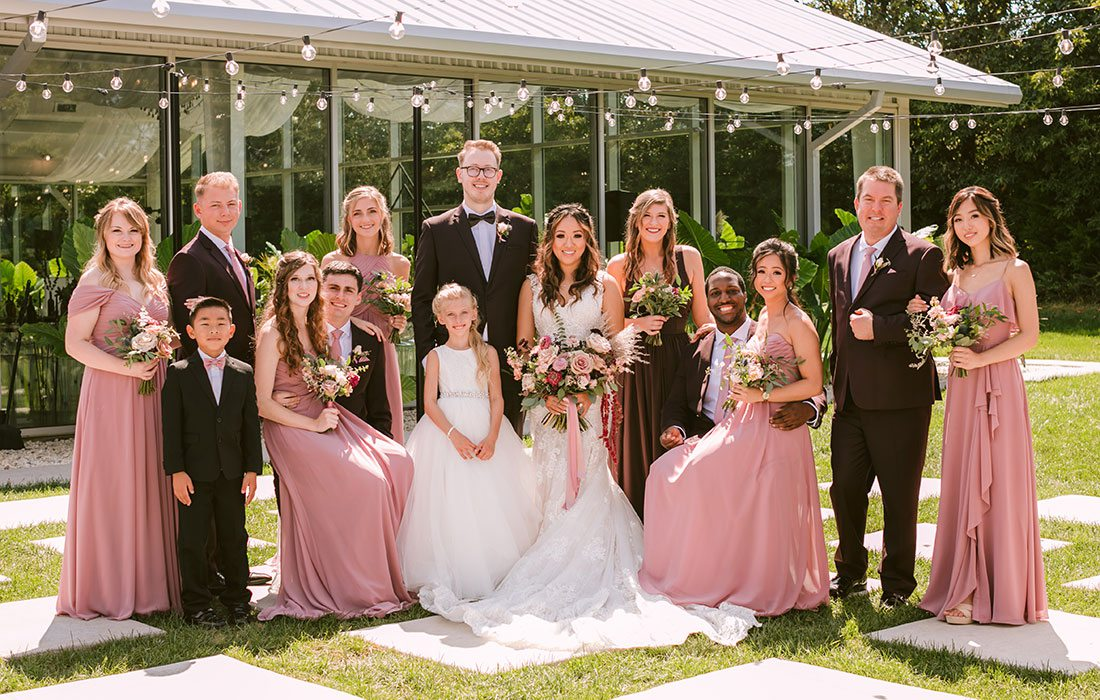 Regan King & Cindy Chao with their wedding party at Greenhouse Two Rivers