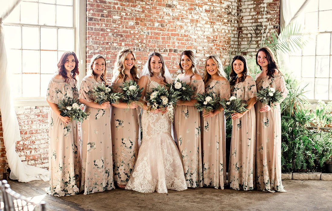 Bride Ali Suman and her wedding party on her wedding day at Venue on Brick in Ozark MO