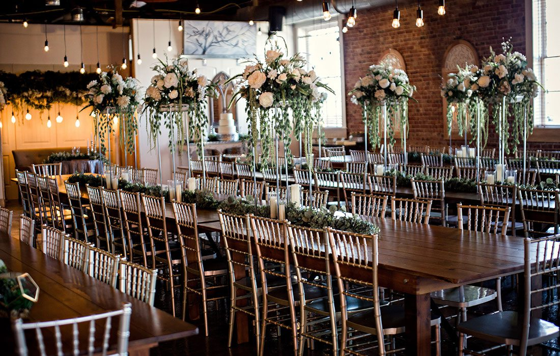Ali Suman & Rick Peery's wedding table settings at Venue on Brick in Ozark MO