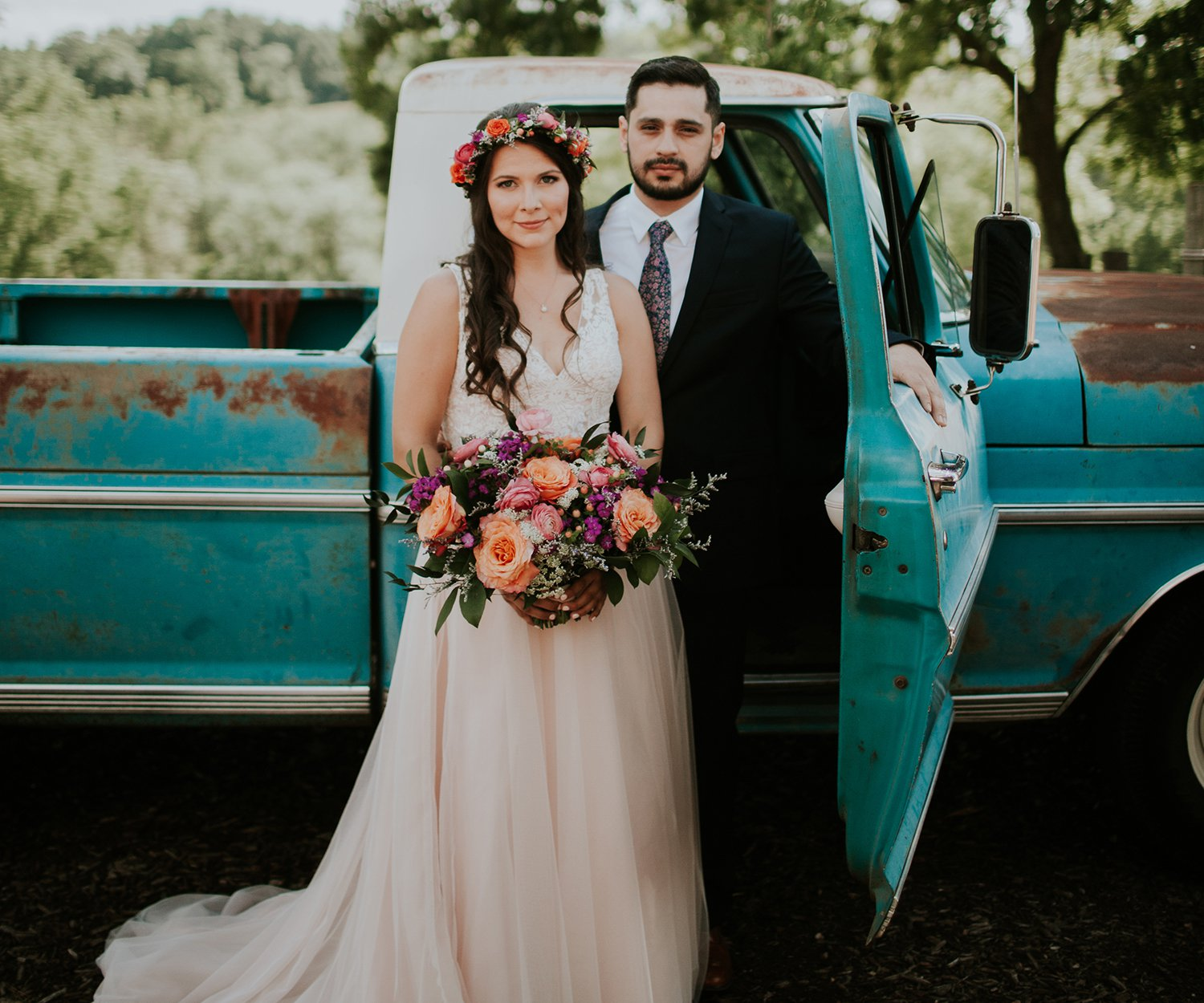 Mackenzie Lee & Ricky Hernandez wedding portrait with an old pickup truck