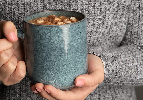 Woman holding a mug of hot cocoa