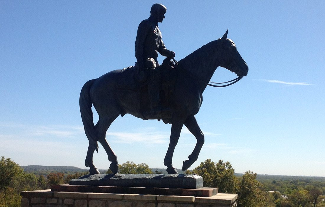Statue of Will Rogers on horseback