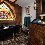 Slider Thumbnail: Rivercliff Estate Stained Glass Above Vintage Tub