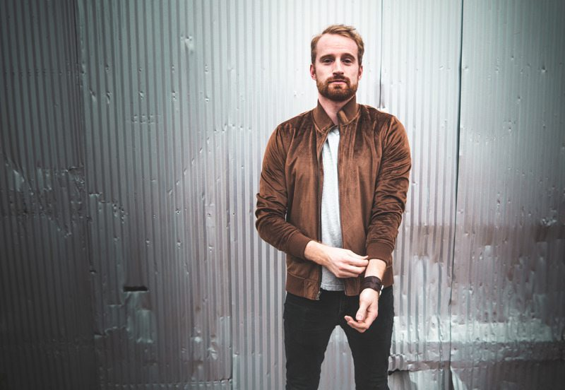 man in a brown jacket