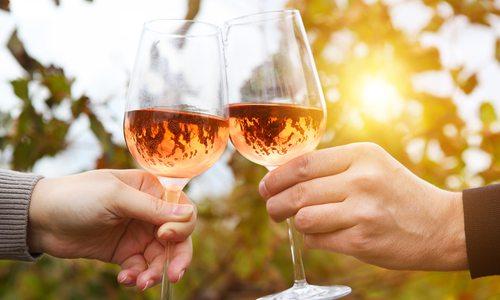 Clinking glasses of rose wine